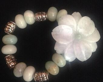 Carved jade flower bracelet.