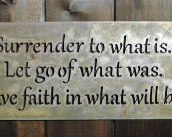 """Surrender"""", is a laser cut metal sign with a natural finish. It measures 16"""" wide and 15"""" tall."""