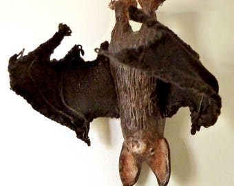Bat on a trapeze sculpture figurine