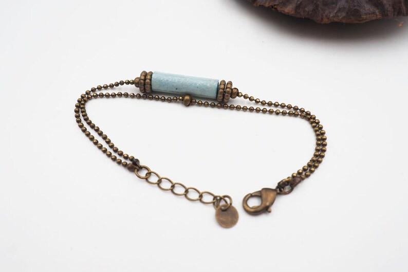 adjustable beaded bracelet in light blue and brass image 0