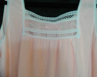 Peach sheer nightgown with white lining and trim.
