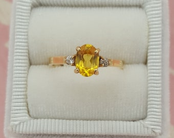 Yellow Sapphire Accented With White Diamonds Set in 14 kt Yellow Gold Designer Engagement Ring