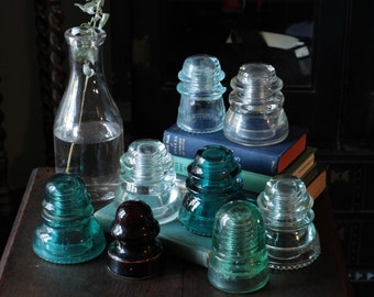 Set of eight glass insulators, vintage decor