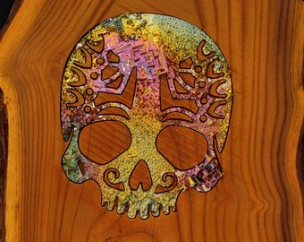 One of a kind Bismuth Skull set in Russian olive rough cut slab on iron stand