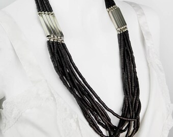 Long vintage multi chain with metal connection