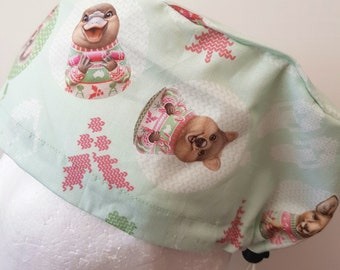 scrub hat surgical scrub cap/Aussie xmas animal baubles on pale green /elastic toggle back/ for theatre nurses doctors dentists vets & more