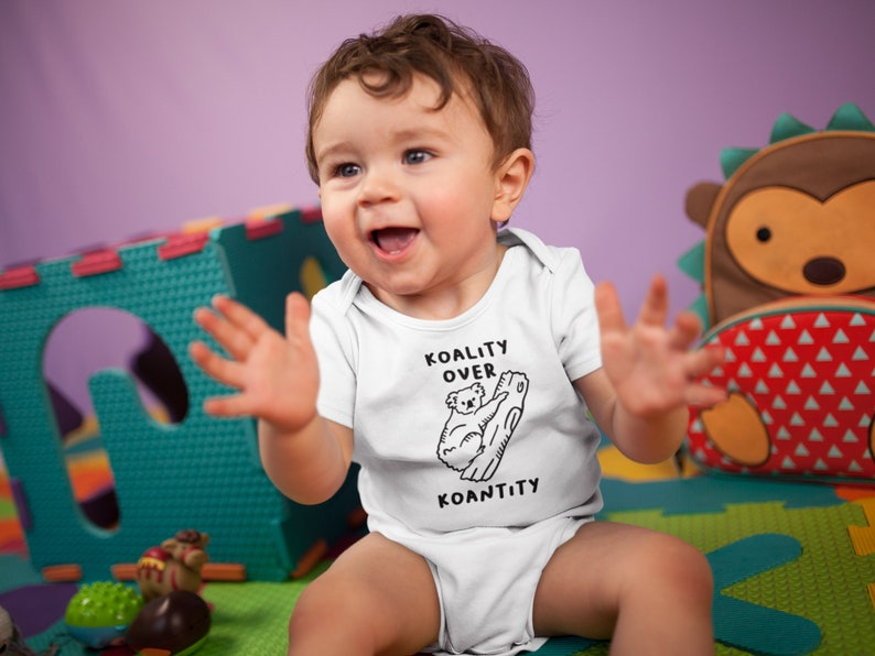 Koality Over Koantity Baby Onesie