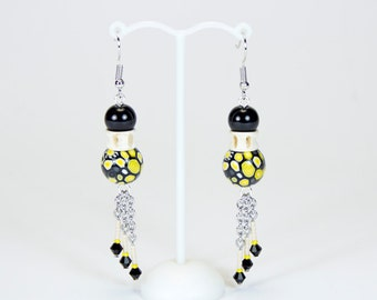Original black and yellow earrings, fish vertebrae and handmade polymer paste beads. Atypical jewelry. Unique piece