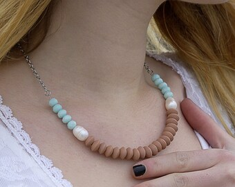 Freshwater pearl necklace, wooden washers and glass beads. Light green mid-length necklace. Mid-season wood and pearl jewelry