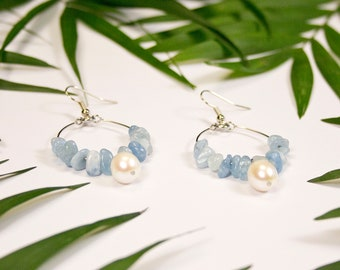Aquamarine creoles and freshwater pearls. Fine stone and pearl earrings. Pearl jewelry and stones. Light blue jewel