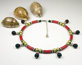 Red and black ethnic necklace. Stripeed necks. Red, black and gold jewelry. Short necklace with several pendants. Heishis striped jewelry