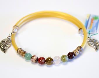 Various stones, gold cord bracelet