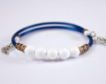 Benefactor beaded bracelet with dark blue cord. Memory wire bracelet with charms. Jewel in benefactor. Jewel in shellbeads