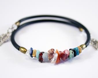 Bracelet beaded with gemstones, black cord