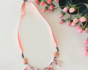 Peach floral bunting necklace
