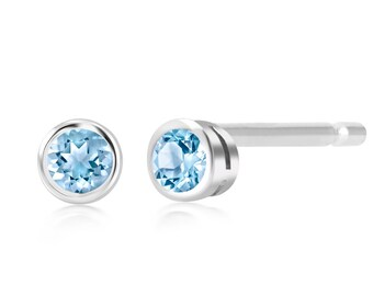 94deedbc0 Blue Topaz Bezel set Stud Earrings Measuring 0.16