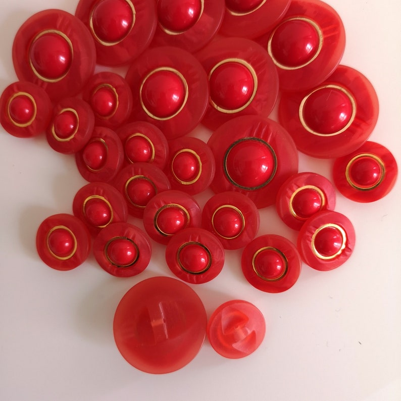 VINTAGE Clear Red Gold Carved Buttons NOS