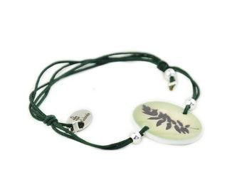 Bracelet, green leaf, plant from Lapland with a dark green satin / macramé ribbon , string, arctic plants