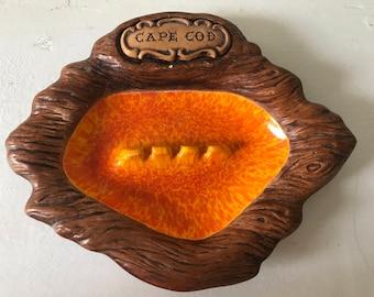 Vintage Cape Cod souvenir ceramic ashtray faux woodgrain and orange ceramic glaze marked Treasure Craft made in USA