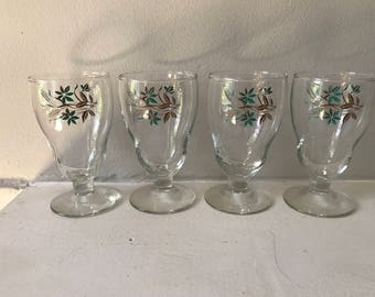 Set of 4 footed short wavy glasses with turqoise and tan flowers/wheat stalks