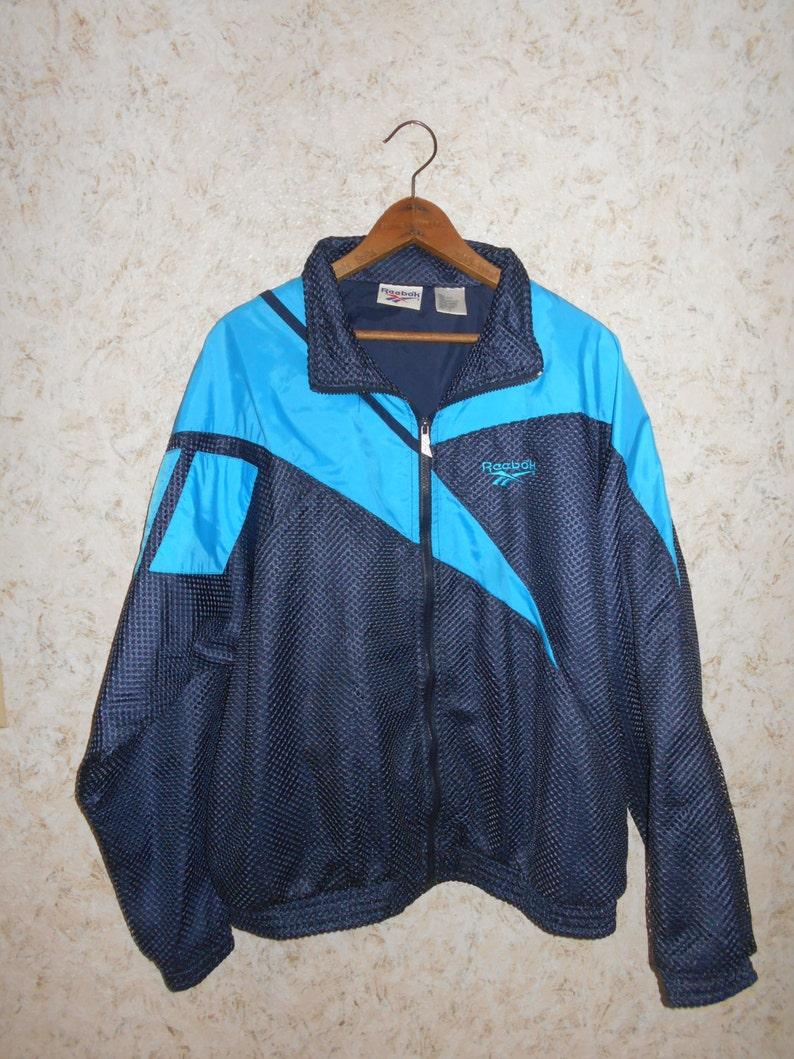 297f0d13dc8c3 Vtg 90s Reebok Rare Mesh Nylon Windbreaker Blue Jacket Coat Zippered Front  Track Jogging Hipster Hip Hop Mens Size Large