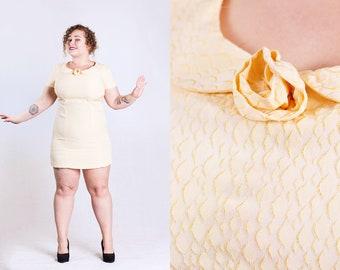vintage 1960s bombshell party dress peter pan collar textured fabric peach mini dress size XL Extra Large