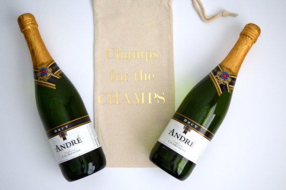 Champs for the CHAMPS - Canvas Drawstring Wine Bag: Gold Lettering
