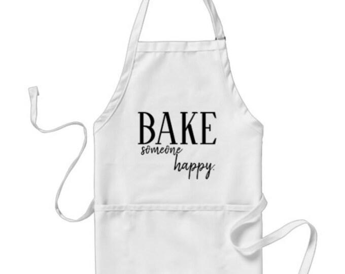 "Apron ""Bake Someone Happy"" Tan and White, Three Pockets, Kitchen Accessories"