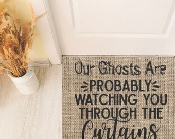 """Halloween Doormat, Burlap Design """"Our Ghosts Are Probably Watching You Through the Curtains"""""""