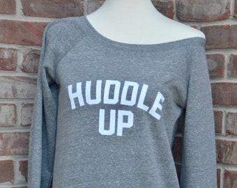 Huddle Up ladies' sponge fleece wide neck sweatshirt.