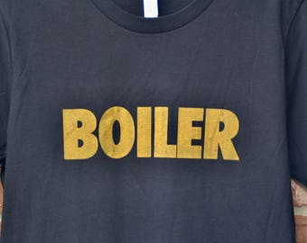 Boiler tee. Boiler short-sleeved black tee. Boiler basketball. Boiler football. Boiler shirt.
