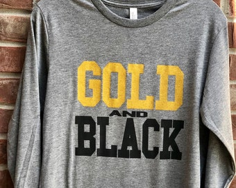 Gold and Black long sleeved tshirt.