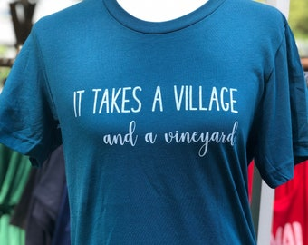 It takes a village and a vineyard graphic tee.
