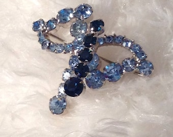 Light and dark blue rhinestone brooch