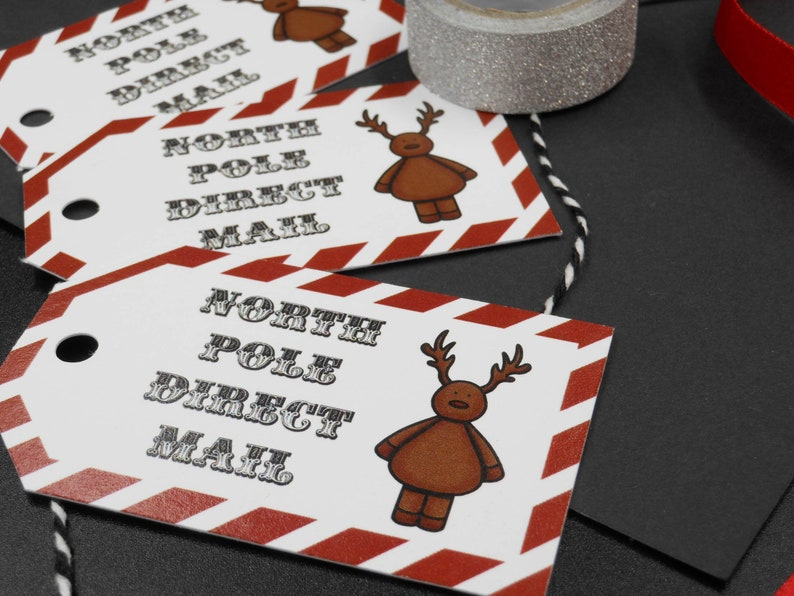 Blank on the back for your own message. North pole gift tag with Reindeer and candy stripe design