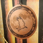 Etched Copper Decoration, featuring a raven in flight, silhouetted against the full moon and surrounded by a border of stars.