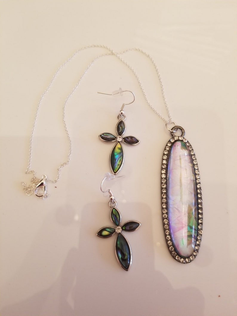 Clear Oval Pendant Necklace with shades of green and gold accents and a pair of matching Cross Earrings SKU #UVF2PP125