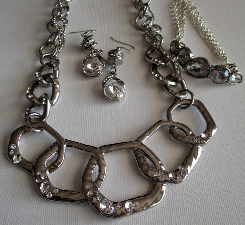 Silver and Crystal  Necklace SKU #UVFP3P104 Pierced Earrings and bracelet