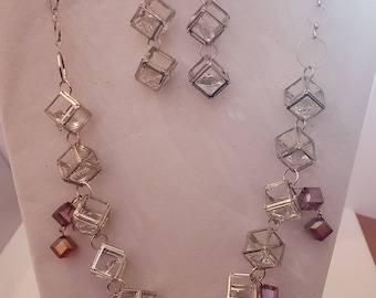Silver Squares, Clear Crystal Center Red Crystal Square Necklace; Silver Squares Crystal Center Red Crystal Square Earrings (SKU# UV3P1029)