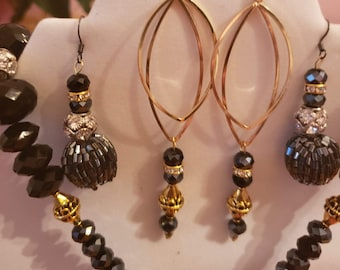 Gold and black Necklace and two pair of Earrings (SKU #UV3P1002)