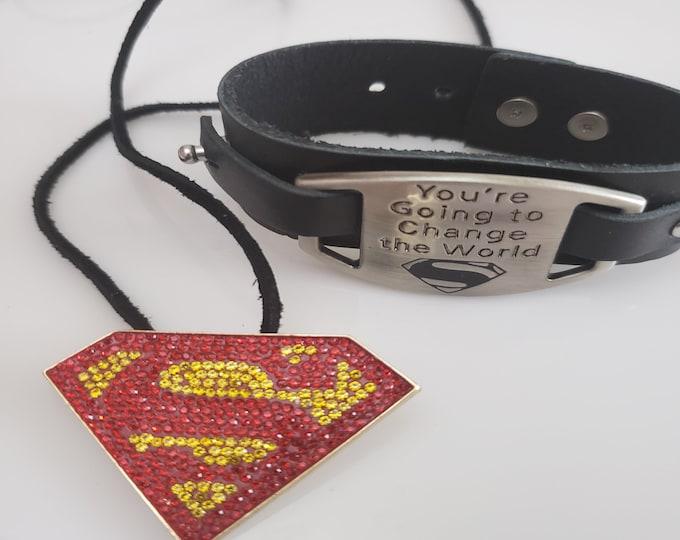 Featured listing image: Superman gold and red pendant, black rope necklace; black leather change the world super hero bracelet, pendant  (SKU# UV2PY1003)