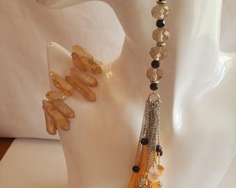 Orange tassel, silver chain earring dangles; orange semi-precious stone bracelet; orange oval bead ring silver dots trim (SKU #UV3P1000)