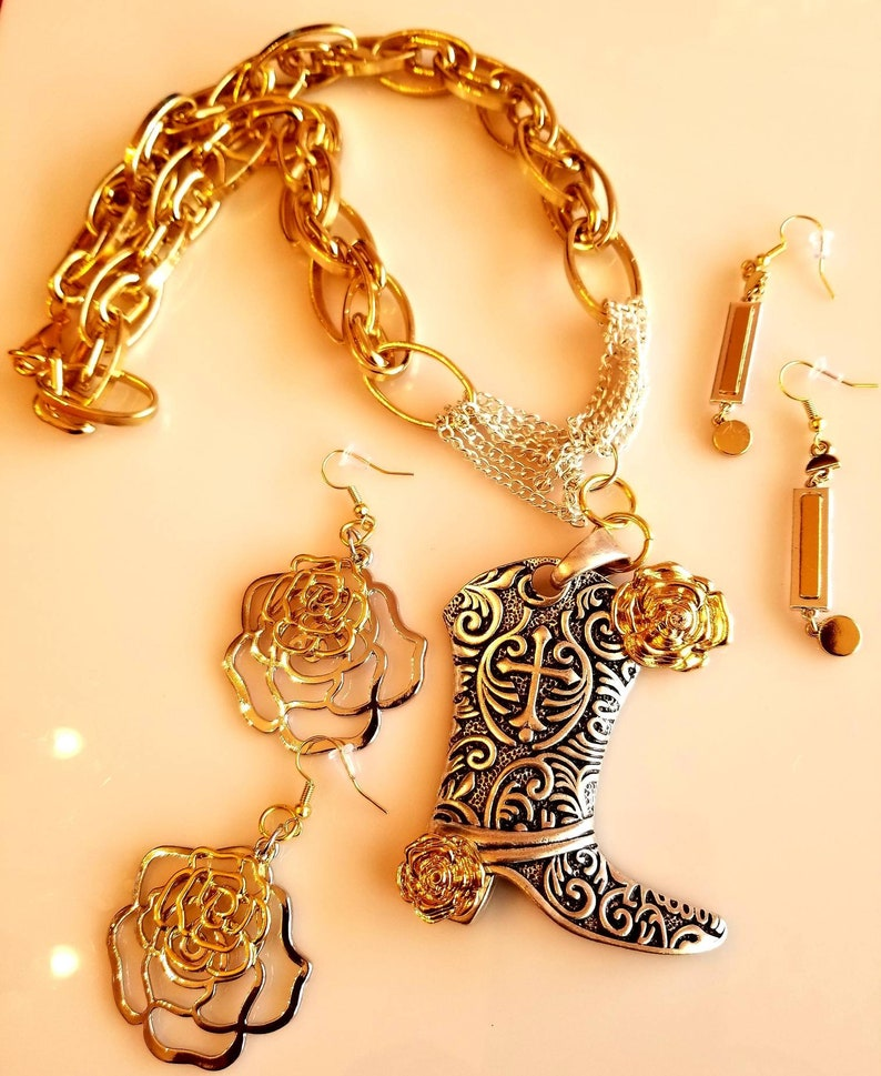 SKU #UV3P860 Gold and Silver Flower Cowboy Boot Pendant Necklace with two pair of Earrings