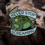 Never Stop Screaming Hard Enamel Pin