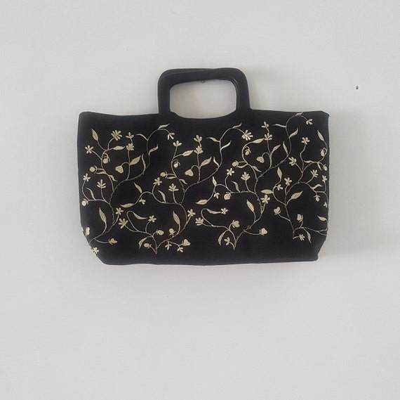 Handbag, embroidered fabric with wooden handles