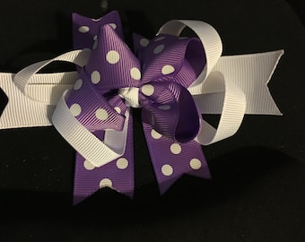 Purple and white polka dot hair bow on alligator clip