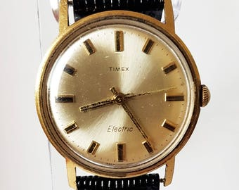 dca7276f8678 Gold Plated Timex Electric Watch - Unisex Timex Watch - Black Leather Band  - Gold Watches