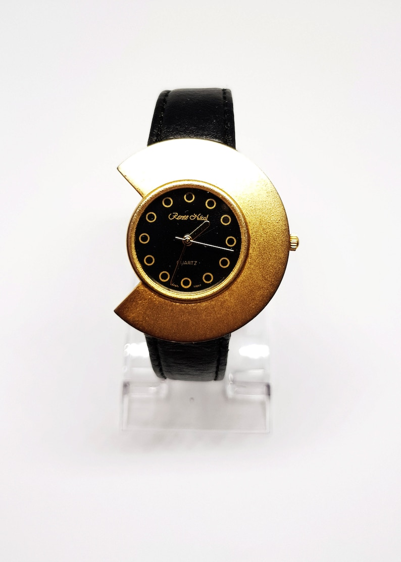 4de0f949431de Womens round oval black and gold watch for women Strange Gift
