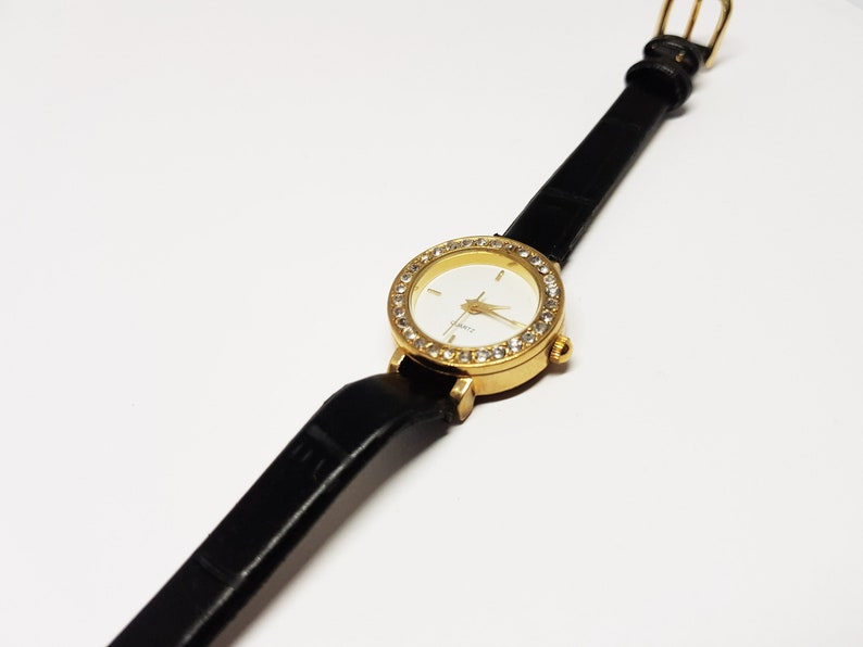 63f7812ab619 Small watch for girls Color  Gold watch Black watch Quartz