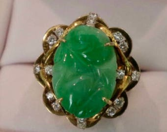 14k Jadeite Jade and diamond ring having carved oval cut jade surrounded by round cut diamonds; marked '585' inside band size: 7.75, 6.75dwt